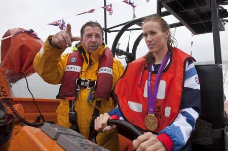Helen Glover at the helm with Patch Harvey Credit Phil Monckton-Large